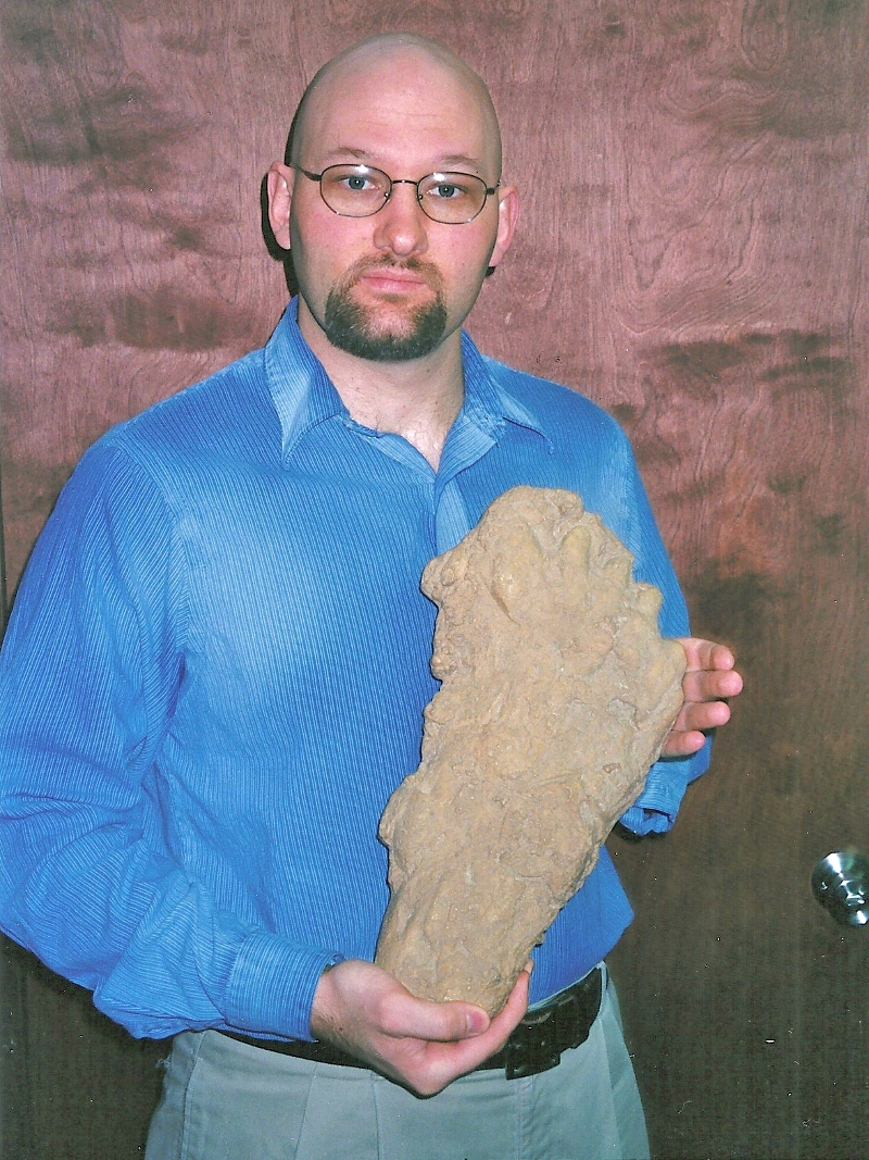 Examining an alleged Bigfoot track.
