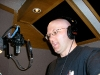 Performing voice-over work in a recording studio for his film Clicker Clatter.