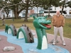 Vanquishing a statue of Ogopogo, the bloodthirsty monster in Lake Okanagan.